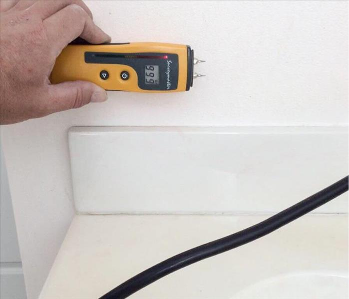 Moisture meter reading wet on drywall
